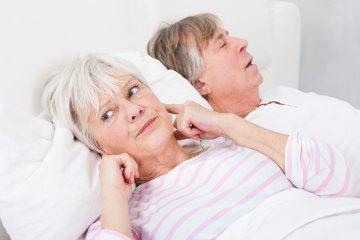 Woman covering ears from man snoring | Nutley Dentist